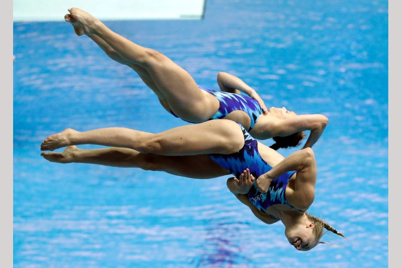 Alison Gibson and Krysta Palmer of the United States compete during the women's 3m synchro...