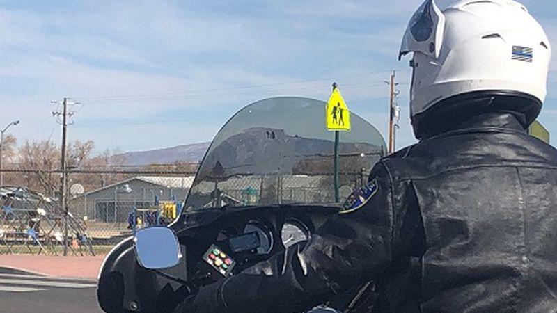 Reno traffic officer monitors traffic in school zone