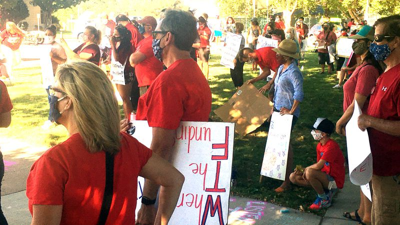 Teachers protest outside the Washoe County School District Administration building. Teachers...