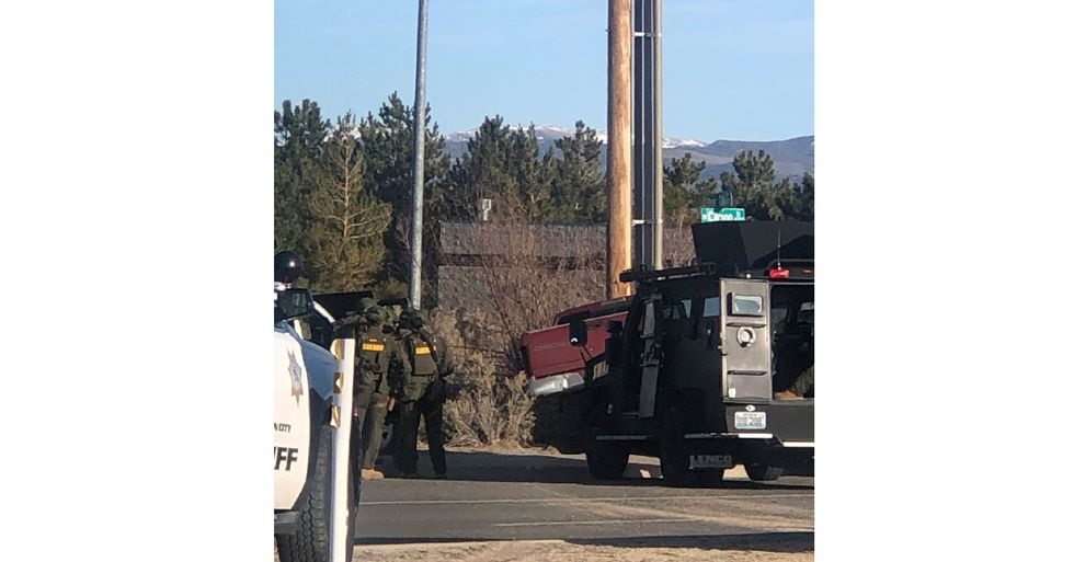 The Washoe County Sheriff's Office said the suspect is in the driver's seat of the red pickup.
