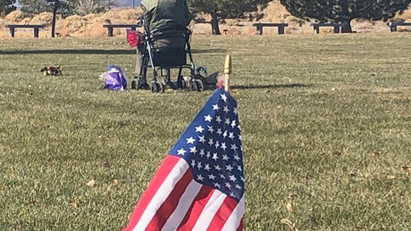 Veteran at headstone at Northern Nevada Veterans Cemetery