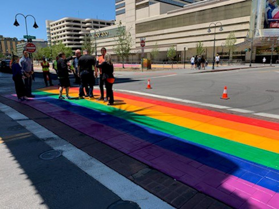 A colorful crosswalk brightens up downtown under the Reno Arch.