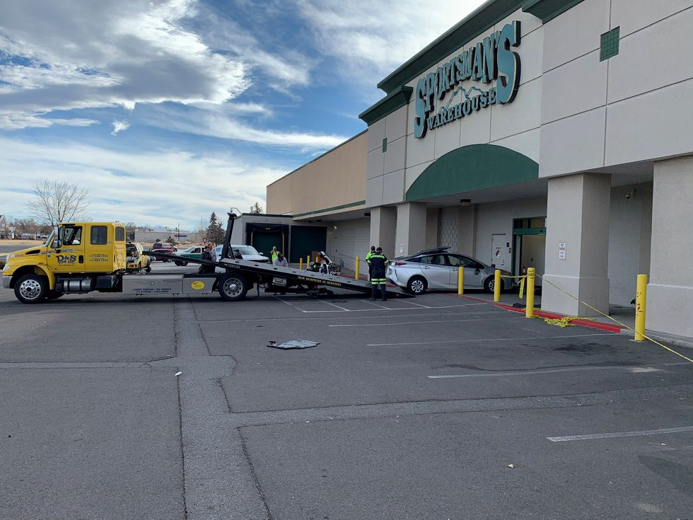 A car is removed after crashing into the Sportsman's Warehouse in Carson City.