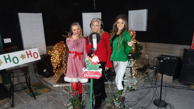 Three women sing for virtual holiday concert.