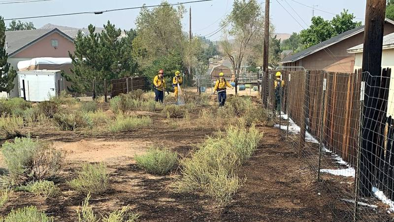 The scene of a small brush fire on Estates Road in Golden Valley.