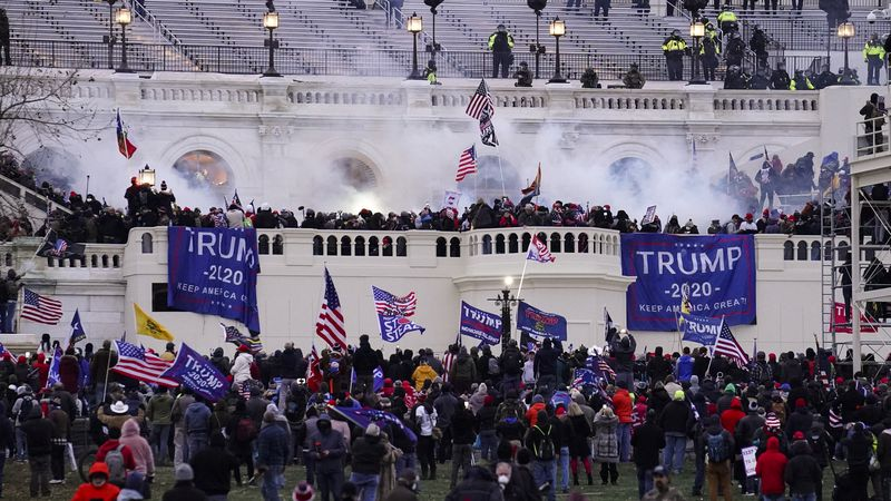 Violent protesters, loyal to President Donald Trump, storm the Capitol, Wednesday, Jan. 6,...
