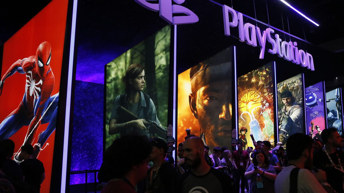 In this June 14, 2018, file people stand online next to the PlayStation booth at the 24th Electronic Entertainment Expo E3 at the Los Angeles Convention Center. Sony said Wednesday, Sept. 16, 2020 its upcoming PlayStation 5 video game console will cost $500 and launch Nov. 12, setting up a holiday battle with Microsoft's Xbox Series X over whose new console will turn up more under the tree this year.