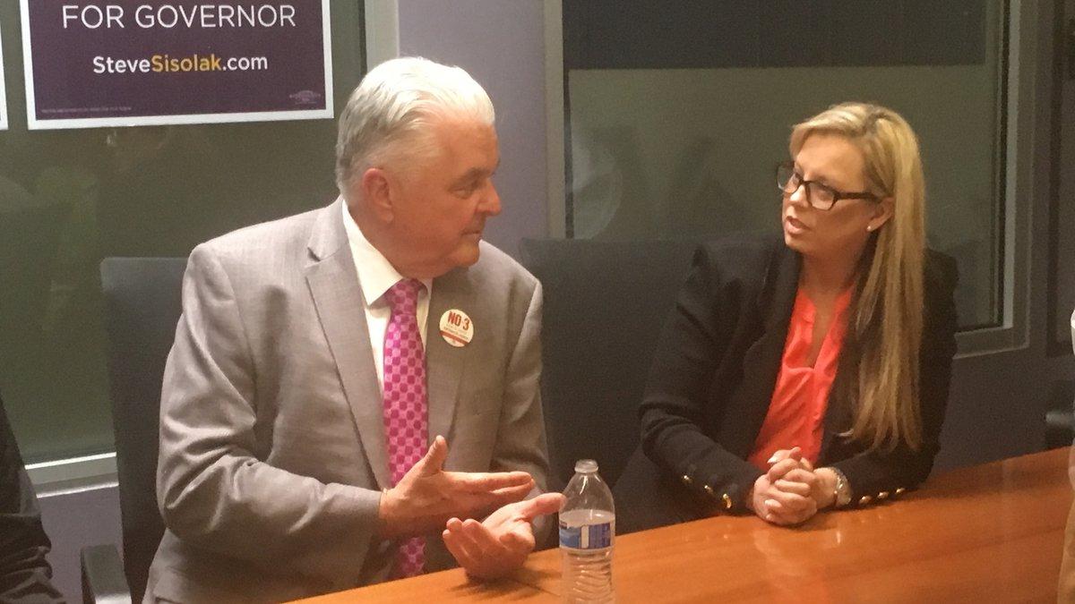 Clark County Commission Chairman Steve Sisolak, left, got Reno Mayor Hillary Schieve's support...