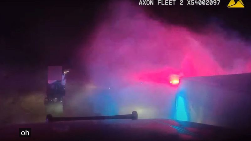 A Sparks Police Department officer fires at truck driven by Joseph Patrick Williams in the...