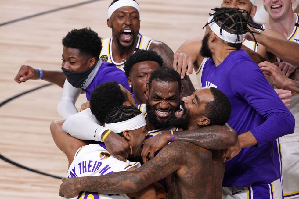 Los Angeles Lakers' LeBron James (23) celebrates with his teammates after the Lakers defeated...