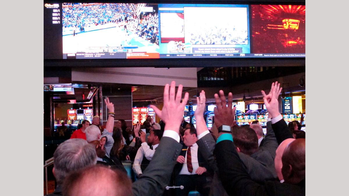 Fans watch college basketball in the sports betting facility at the Tropicana casino in...