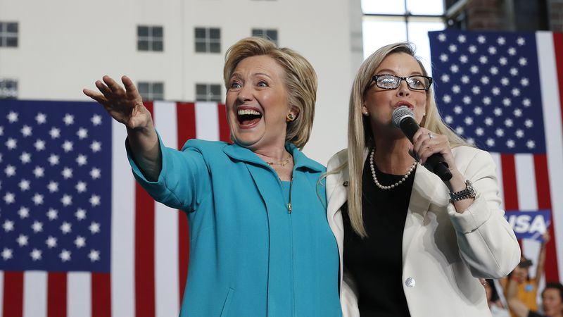 Democratic presidential candidate Hillary Clinton, left, waves as she is introduced by Reno...