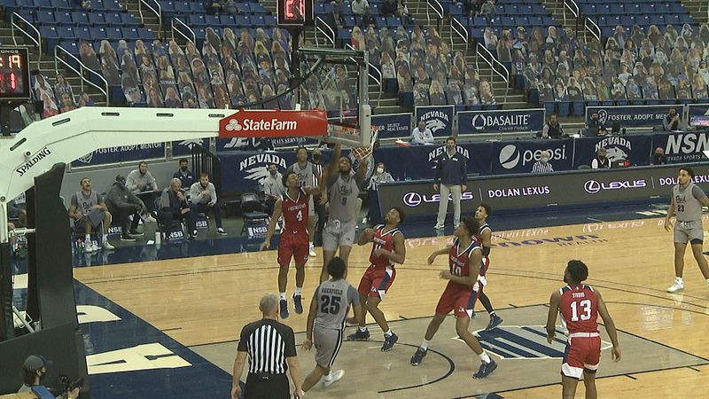Warren Washington goes up and finishes the lob from Grant Sherfield as the Wolf Pack beats the...