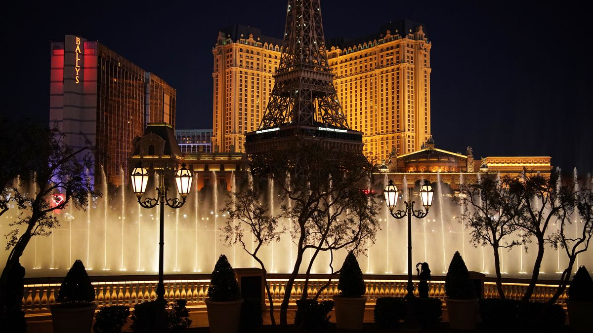 A woman watches the fountains at the Bellagio hotel-casino along the Las Vegas Strip, Thursday,...