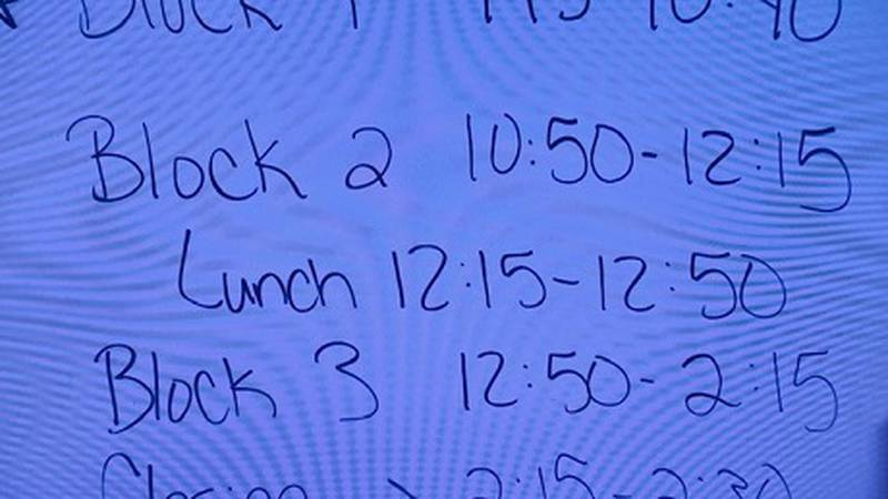 White board at Reed High School showing summer school daily schedule