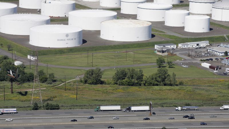 FILE - In this Sept. 8, 2008 file photo, traffic on I-95 passes oil storage tanks owned by the...