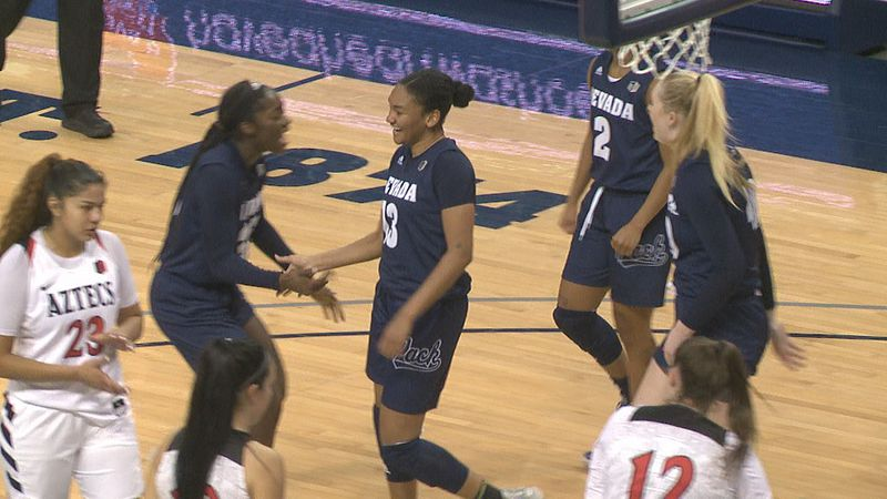Amaya West high-fives Nia Alexander after scoring a basket against San Diego State on Saturday