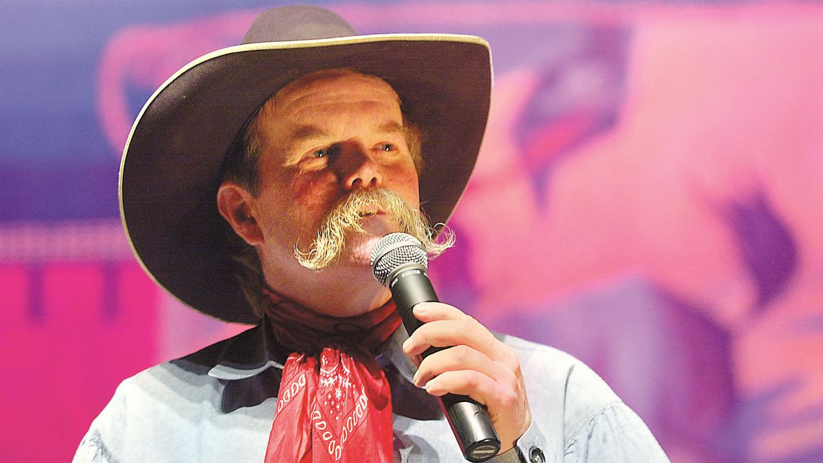 Cowboy Waddie Mitchell tells a tale during the 2005 National Cowboy Poetry Gathering in Elko, Nevada at the Elko Convention Center. (AP/Photo/Elko Daily Free Press, Ross Andreson).