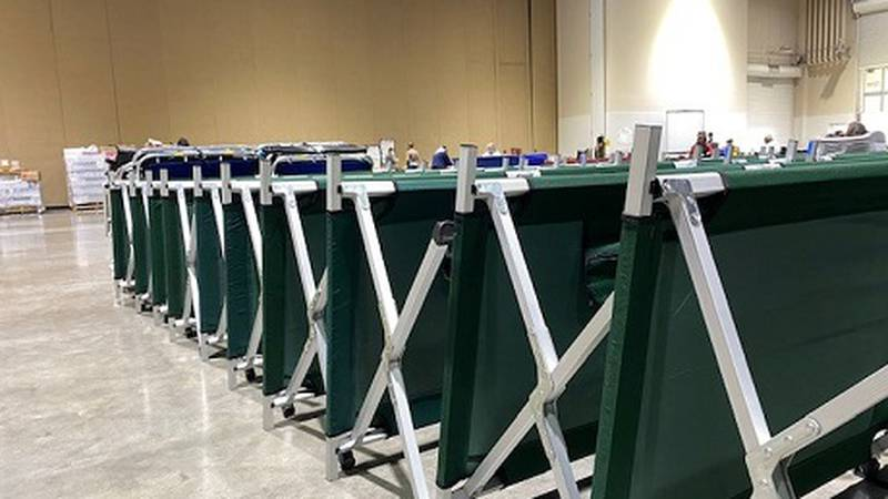 Cots formerly used for SLT evacuees stacked at the Reno Sparks Convention Center.