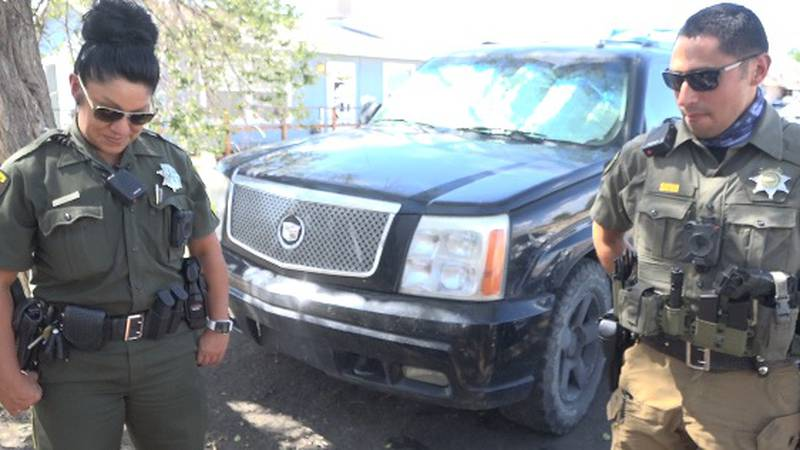 Sgt. Shatawna Daniel and Deputy Andres Silva of Washoe County's new HOPE team offer services to...
