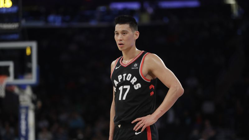 In this March 28, 2019, file photo, Toronto Raptors' Jeremy Lin stands on the court during the...