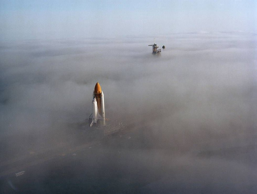 Four years before exploding over Kennedy Space Center, Space Shuttle Challenger creeps through...