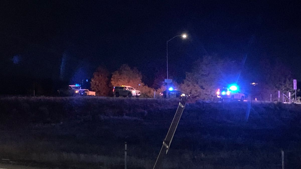 Reno Police and Washoe County Sheriff's deputies investigate a shooting along the Mogul offramp on I-80