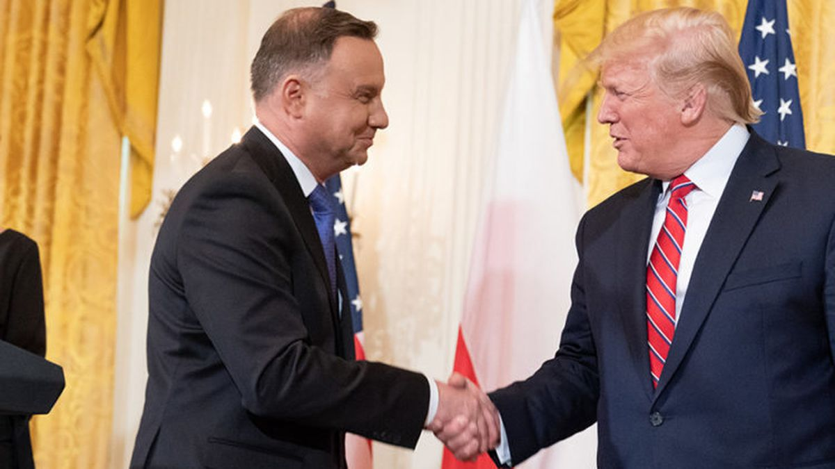 President Donald J. Trump shakes hands with Polish President Andrzej Duda after delivering...