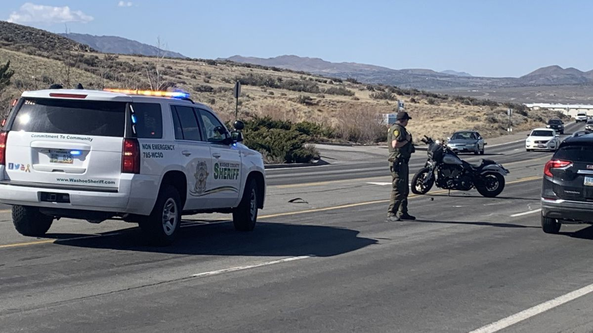 Washoe County Sheriff's Office deputies investigate a crash involving a truck and motorcycle on...