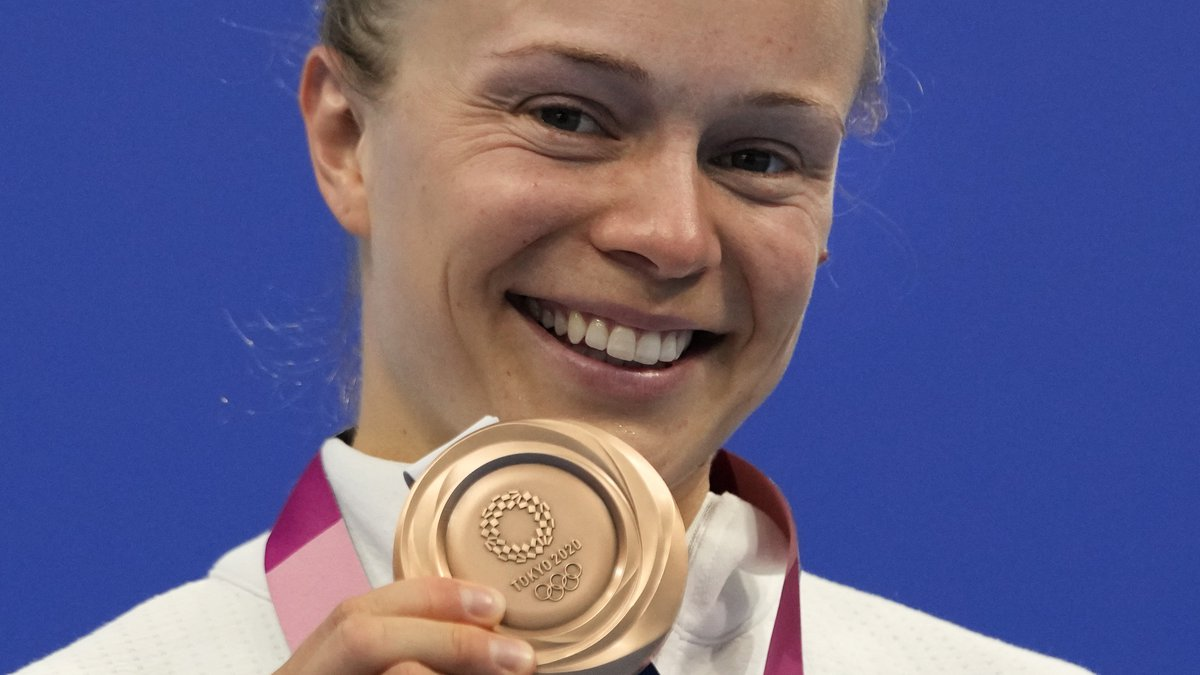 Krysta Palmer of the United States' pose for a photo after winning bronze medal in women's...