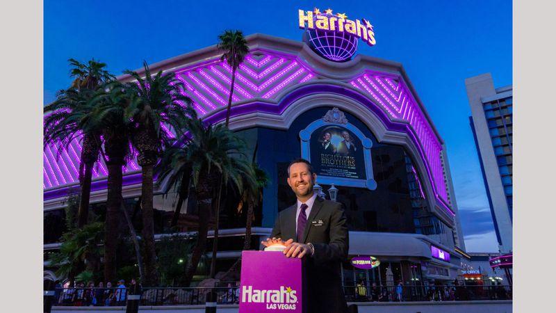 Harrah's Las Vegas Senior Vice President & General Manager Dan Walsh switches on the...