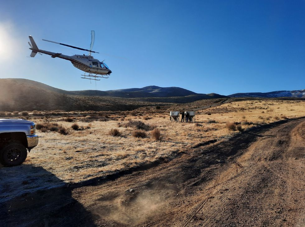 Crews work on a seeding project of more than 1,000 acres burned by the Poeville Fire.