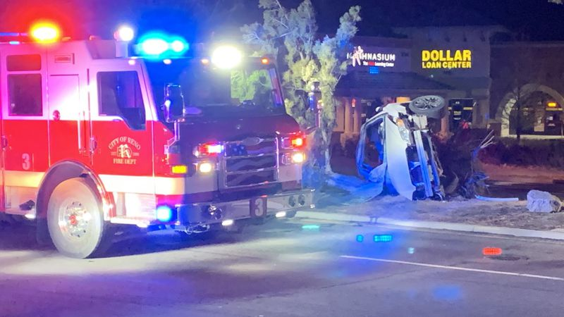 The scene of a rollover crash on Double R Blvd. that injured 3 people.