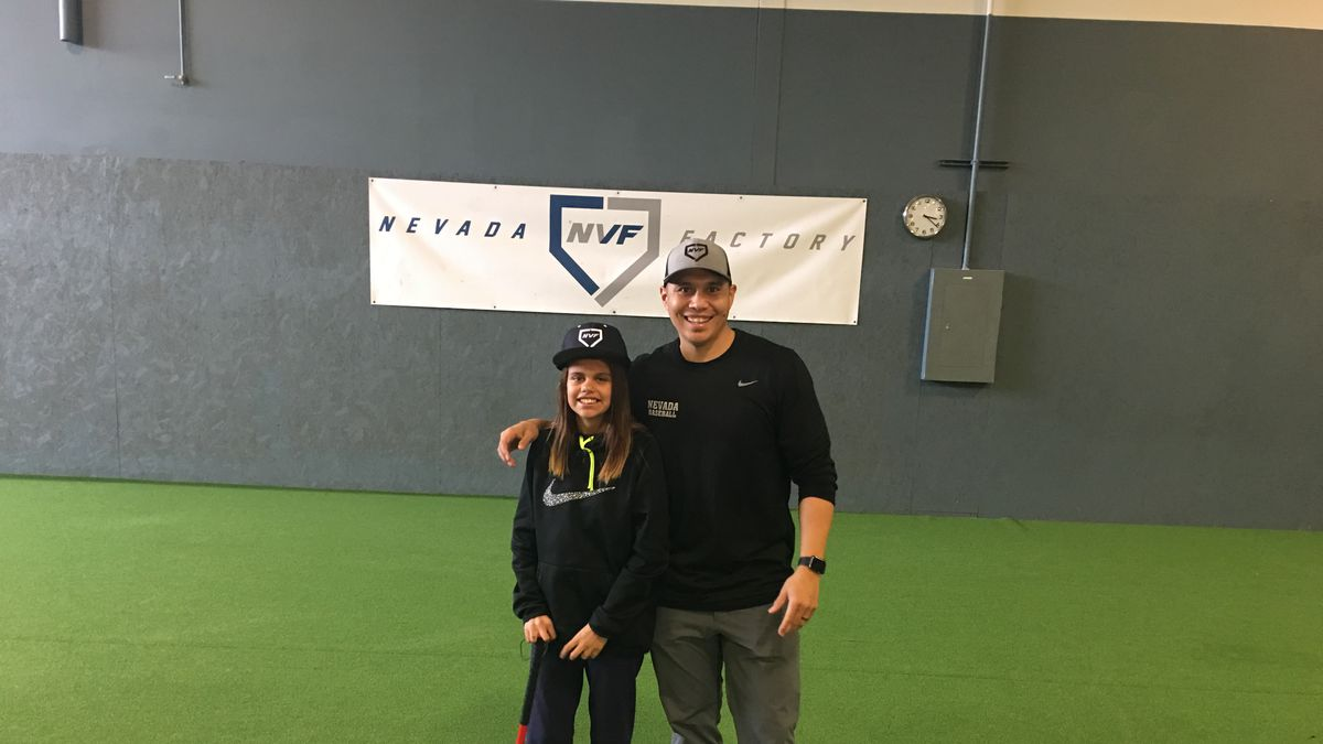 12-year-old Christina is looking for a family to adopt her. Former MLB outfielder Chris Aguila helped teach her some baseball skills at his Reno, Nev. business Nevada Baseball Factory.