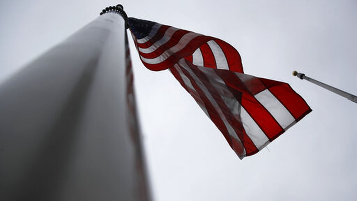 An American flag flies at half-staff at the Washington Monument, Friday, May 22, 2020, in Washington. President Donald Trump ordered American flags to be flown at half-staff for a three day period in remembrance of Americans who have lost their lives due to the coronavirus outbreak. (AP Photo/Patrick Semansky)