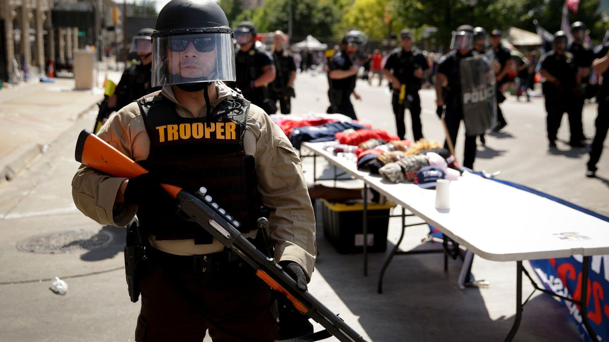 """In this June 20, 2020, file photo a trooper stands outside the BOK Center where President Trump will hold a campaign rally in Tulsa, Okla. In law enforcement, they're referred to as """"non-lethal"""" tools for crowd control: Rubber bullets. Pepper spray. Batons. Flash-bangs. But the now-familiar scenes of U.S. police officers in riot gear clashing with protesters at Lafayette Park in Washington and elsewhere around the country have police critics charging that the weaponry too often escalates tensions and hurts innocent people. (AP Photo/Charlie Riedel, File)"""