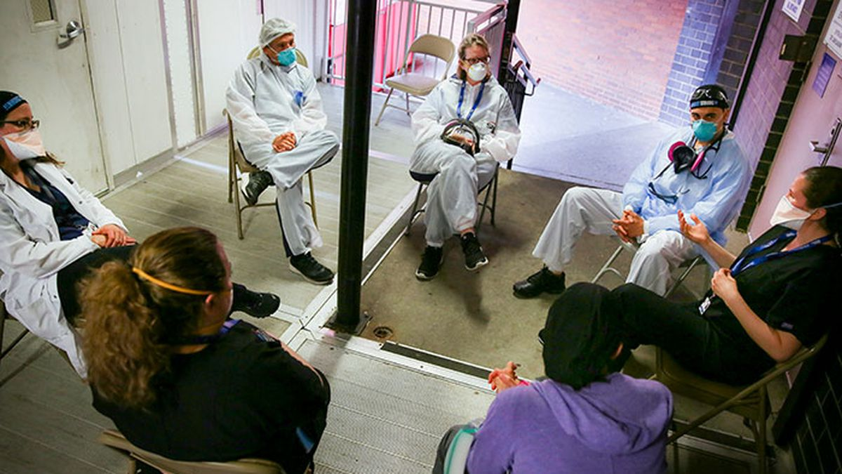 Hospital workers sit for a group counseling session at Elmhurst Hospital to talk about their...