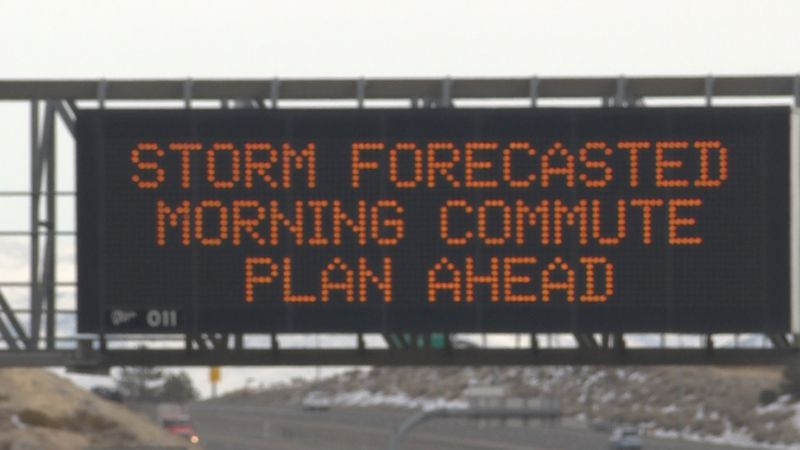 Signs on Interstate 80 warn drivers of an incoming storm