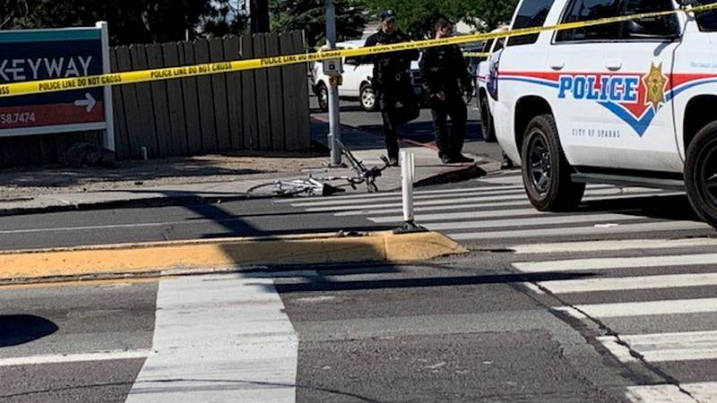 Police respond after a bicyclist was hit by a car on Oddie Blvd. Wednesday morning.