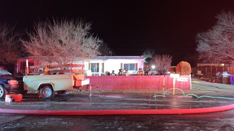 Crews from Truckee Meadows Fire & Rescue respond to a fire at a home on Bozic Lane in Sun...