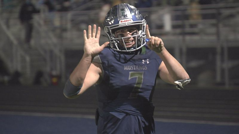 Damonte Ranch's Ethan Kulpin gives the camera some love during the Mustangs' 61-42 win over...