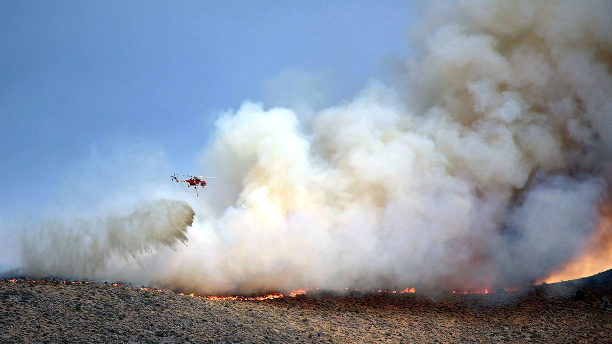 Daniel Fazzari submitted this photo o a helicopter bringing water to the Prison Hill fire in...