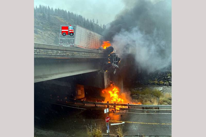 The California Highway Patrol posted this photograph of a tractor-trailer rigs on fire after...