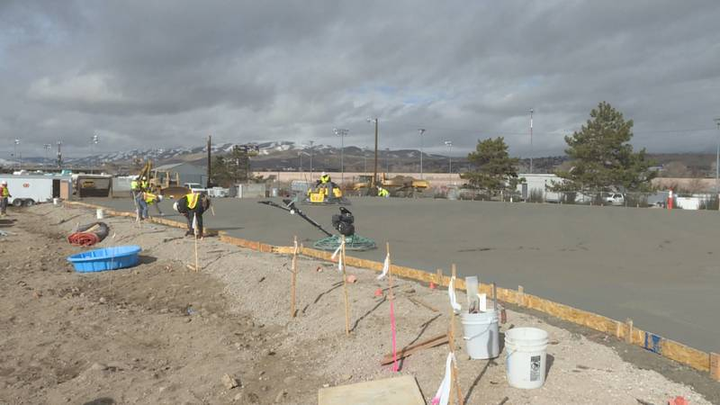 Crews lay concrete on the new homeless shelter just off of E. 4th St.