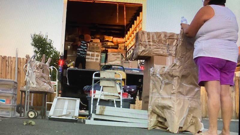 Movers arrive with Sonya Carroll's belongings