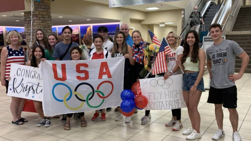 Krysta Palmer (4th from right) lands at the Reno-Tahoe International Airport after qualifying...