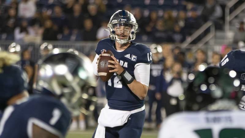 Nevada quarterback Carson Strong (12) looks to throw against Hawaii in the second half of an...