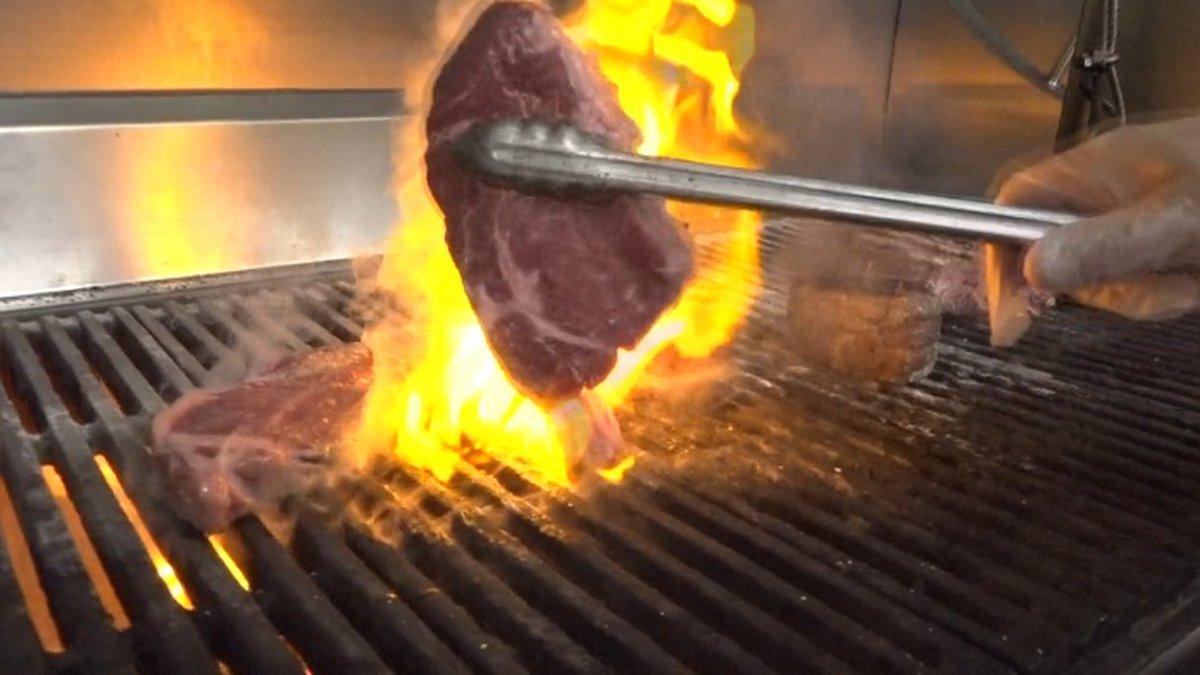 Bimini Steakhouse Chef de Cuisine Neil Campbell turns steaks inside the Peppermill Resort Hotel.