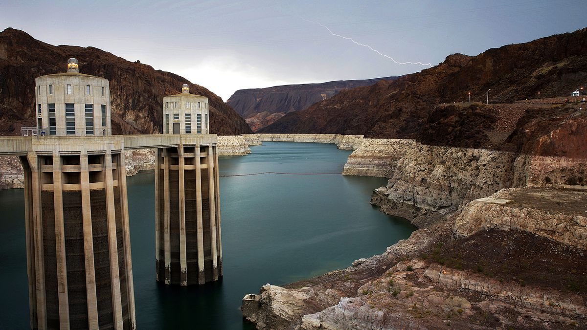 In this July 28, 2014, file photo, lightning strikes over Lake Mead near Hoover Dam that...