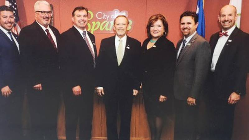 The late Sparks Mayor Ron Smith poses with City leaders for a picture.
